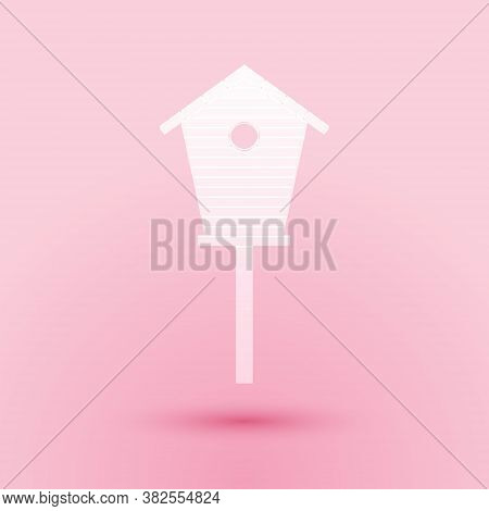 Paper Cut Bird House Icon Isolated On Pink Background. Nesting Box Birdhouse, Homemade Building For