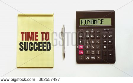 Clipboard With Pen And Calculator Isolated On White. Text Time Succeed