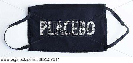 Black Disposable Protective Mask With Placebo Text On Black Background.