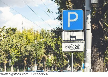 Isolated Parking Sign - Blue Road Sign With Letter P On Rectangular Plate Isolated Against A Blue Sk
