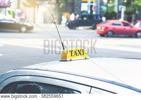 Yellow Taxi Sign By Taxi Car In The Afternoon Or Morning On City Street