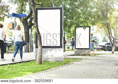 Blank Mock Up Of Vertical Street Poster Billboard On City Background