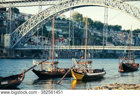 Porto, Portugal: Douro River And Many Riverboats Floating Past Old City On 19 May, 2019. Portuguese