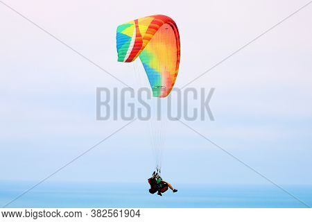 August 24, 2020 In La Jolla, Ca:  Paraglider Gliding Above The California Coast Taken At The Torrey