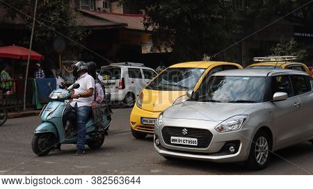 Mumbai, Maharastra/india- January 04 2020: People With Their Car Stuck In A Traffic Jam. Two And Fou