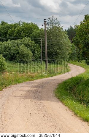 Curvy Gravel Countryside Road In The Lithuania