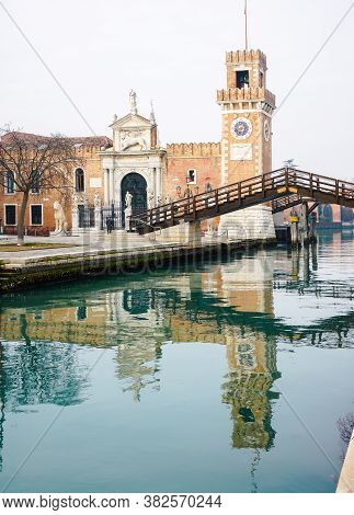 Venice, Italy - January 2020: Venetian Arsenal Tower And Ponte Del Paradiso Reflected On The Canal W