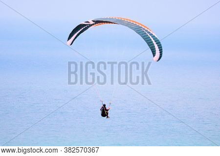 August 24, 2020 In La Jolla, Ca:  Person On A Paraglider And Gliding Over The Pacific Ocean Taken Fr