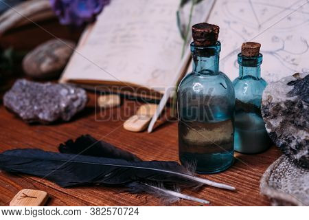 Witchcraft Concept With Potions, Herbs And Occult Equipment