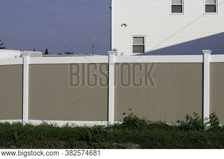 White And Gray White Vinyl Fence Close Up Dessing Residential