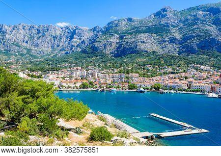Scene The Makarska City And Mountain Biokovo. Sunny Day. Dalmatia, Croatia.