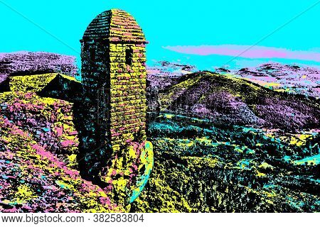 Small Watchtower And Wall Over Rocky Cliff On Hilly Landscape In Marvao. A Medieval Fortified Villag