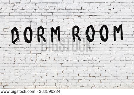 White Brick Wall With Inscription Dorm Room Handwritten With Black Paint