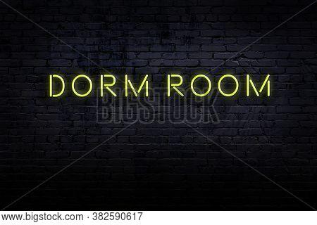 Neon Sign On Brick Wall At Night. Inscription Dorm Room