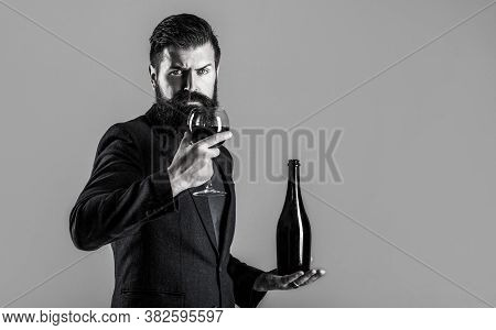 Red Wine In Bottle, Wine Glass. Red Wine In A Glass. Man Holding Bottle With Champagne, Wine. Beard