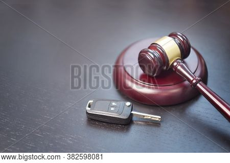 Driver License Revocation Concept Next To The Judge Hammer. Traffic Violation Concept By Car Next To