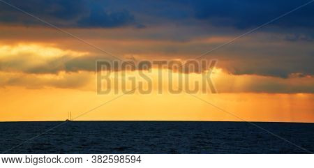 Sunset. Ocean Scenery. Virgin Nature Landscape. Beautiful Golden Sky. Calming Water. Open Sea. Float