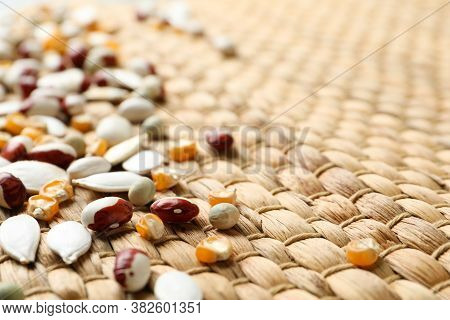 Mixed Vegetable Seeds On Wicker Background, Closeup
