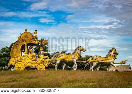 Holly Arjuna Chariot Of Mahabharata In Golden Color With Amazing Sky Background