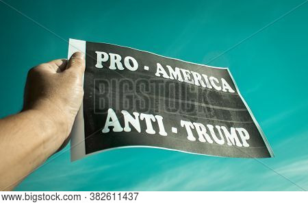 Protests Against President Trump. A Protestor Holds A Political Banner With