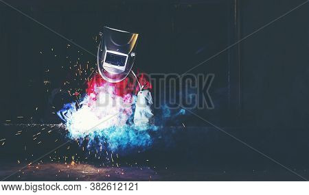 Pipe Welding On The Pipeline Construction,welders With Protective Equipment Welding Outdoors Pipelin