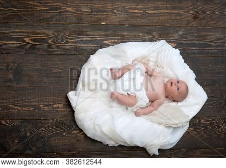 Childhood And Divine Gift Concept. Infant Covered With White Duvet.