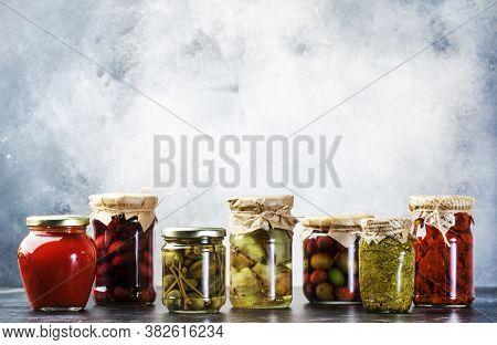 Canned Food Concept. Fermented, Pickled, Marinated Preserved Vegetarian Italian Snacks And Sauces. O