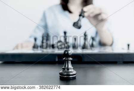 The Hands Of Businesswomen Moving Chess In Chess Competitions Demonstrate Leadership, Followers, And