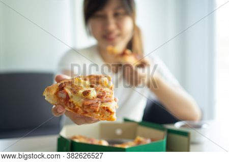 Hungry Woman Enjoys Eating Hawaiian Pizza After Order Online To Eat At Home. Happy And Relaxed To Ea