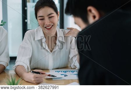 Young Asian Business People Having A Business Meeting