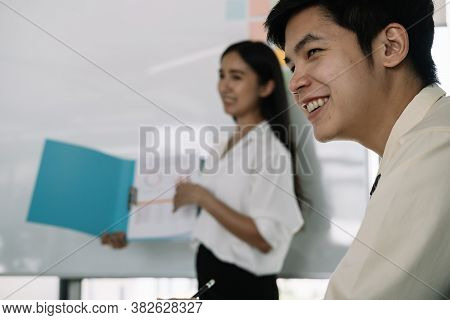 Young Asian Business People In Board Room Meeting At The Office