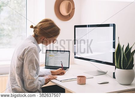 Woman Freelancer Working At Home Office. Girl Wearing In Glasses Works With New Startup Project. Fem