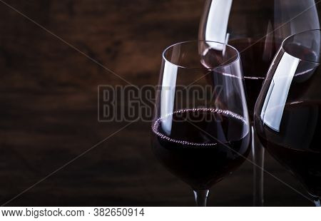 Wine Glass. Selection Of Red Wines On Wine Tasting. Dry, Semi-dry, Sweet Red Wine On Old Wooden Tabl