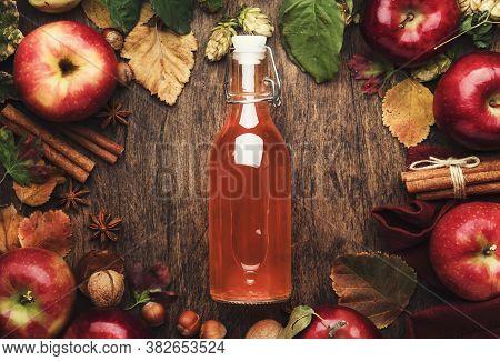 Apple Cider Vinegar. Bottle Of Fresh Apple Organic Vinegar On Wooden Table Background With Cinnamon