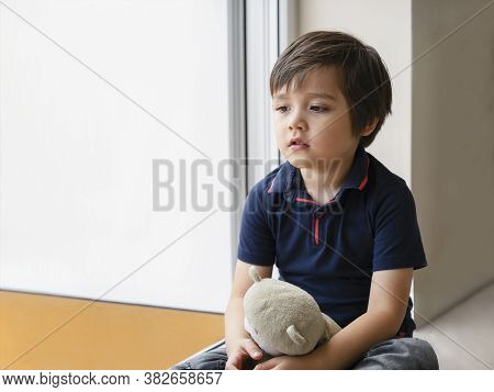 Emotional Portrait Sad Kid Sitting With Teddy Bear, Lonely Kid Sitting On Floor In Corner And Lookin