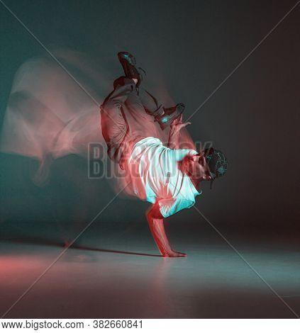 Stylish Young Guy Breakdancer Dancing Hip-hop In Neon Light. Dance School Poster. Long Exposure Shot