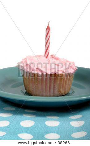 Frosted Cupcake With Pink Candle