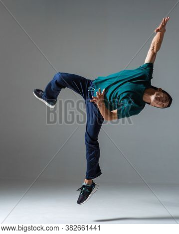 Cool Young Guy Breakdancer Jumps Dancing Hip-hop Isolated On Gray Background. Dance School Poster. B