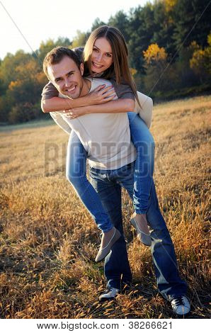 Young couple playing in fall