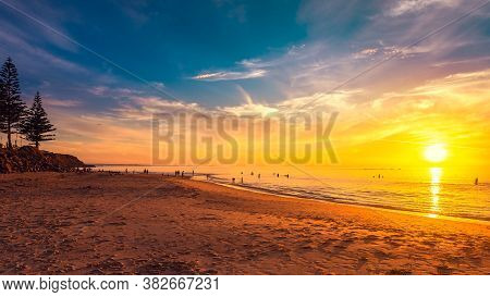 Christies Beach View With People Swimming And Enjoying  Beautiful Sunset On A Warm Summer Evening, S