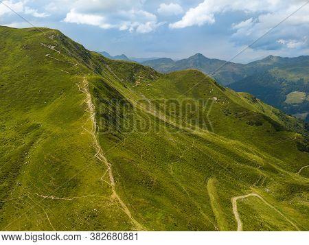 Aerial View On Beautiful Mountain Panorama On The Zwoelferkogel Peak With Summit Cross In The Skiing