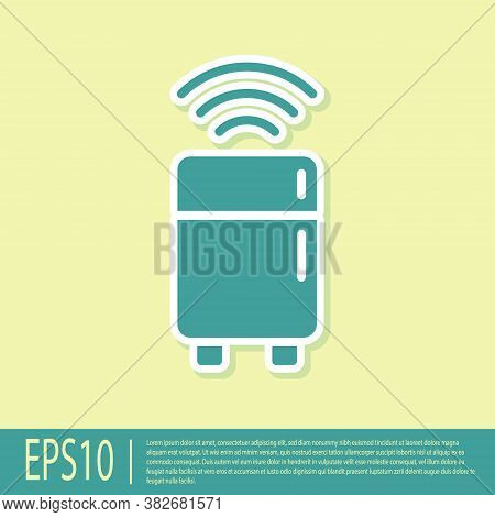 Green Smart Refrigerator Icon Isolated On Yellow Background. Fridge Freezer Refrigerator. Internet O