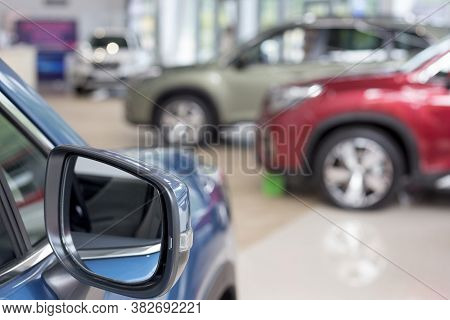 New Cars At Dealer Showroom. Themed Blur Background With Bokeh Effect. Car Auto Dealership.