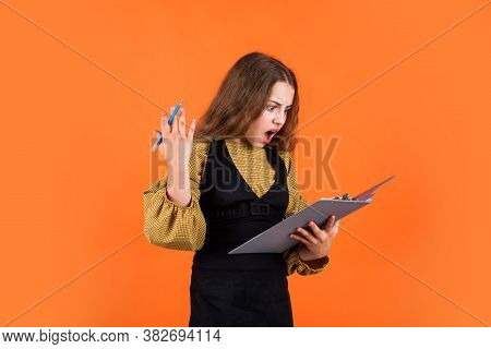 Teen Kid Holds Folder In Hands. Office Life. Get Knowledge From Archive. Young Business Kid Holding