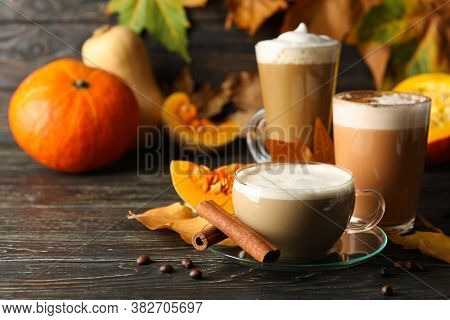 Composition With Pumpkin Latte, Cinnamon And Pumpkin On Wooden Background