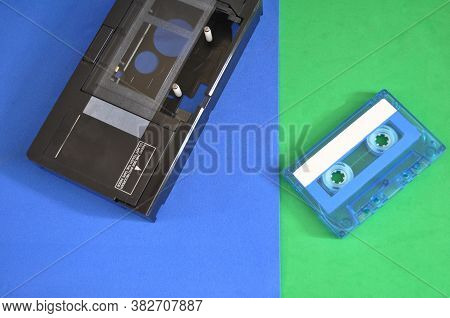 Vhsc Original Adapter Analog Cassette With Audio Cassette On Blue And Green Background