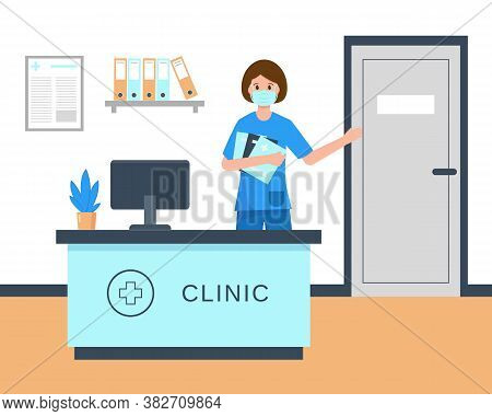 Young Woman Receptionist In Medical Mask Sitting At The Clinic Reception Desk. Hospital Holl Interio