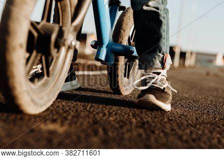 A Boy Rides A Balancing Bike. Active Walk