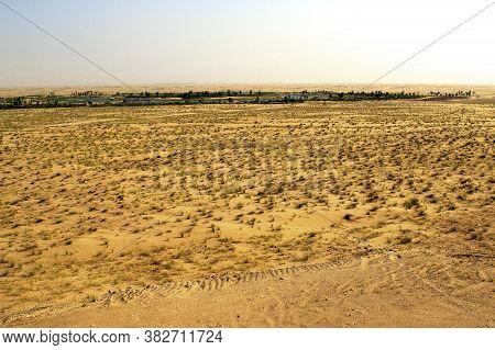 Arabian Desert In Uae With Artificial Expo Lake On A Horizone. Beautiful Flat Arab Desert During Day