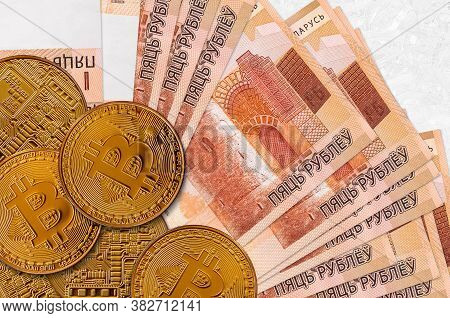 5 Belorussian Rubles Bills And Golden Bitcoins. Cryptocurrency Investment Concept. Crypto Mining Or